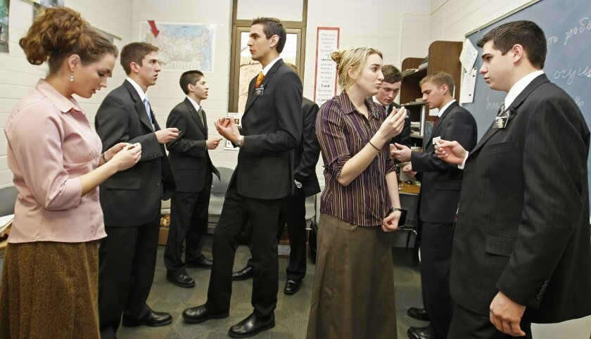 FILE- In this Jan. 31, 2008, file photo, a class of Mormon missionaries practice the Russian language with each other at the Mormon Missionary Training Center in Provo, Utah. Mormon missionaries will remain in Russia despite the country's new anti-terrorism law, which will put greater restrictions on religious work starting later this month. In a statement issued Friday, July 8, 2016, the Church of Jesus Christ of Latter-day Saints said that missionaries will respect a measure that Russian President Vladimir Putin signed into law this week. (AP Photo/George Frey, File)