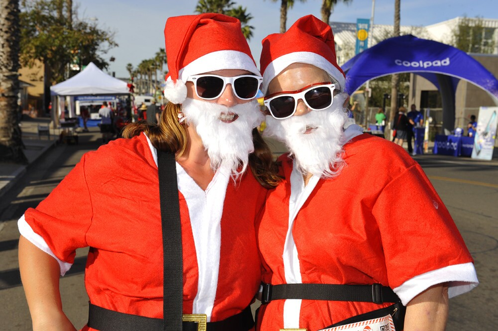 Santas stormed the streets of Pacific Beach for the 5th Annual San Diego Santa Run on Saturday, Dec. 9, 2017.