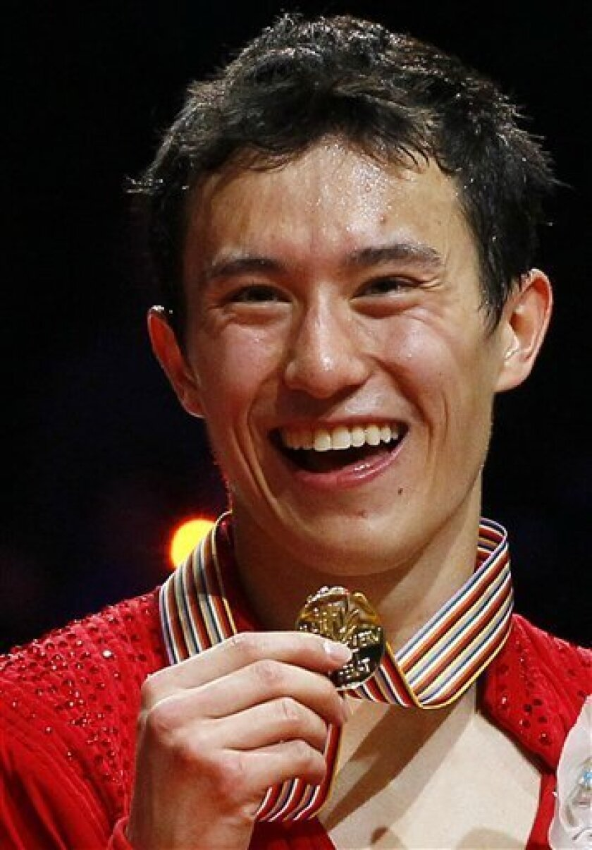 Patrick Chan of Canada shows his gold medal after the Men Free skating at the ISU 2012 World Figure Skating Championships in Nice, southern France, Saturday, March 31, 2012. (AP Photo/ Francois Mori)
