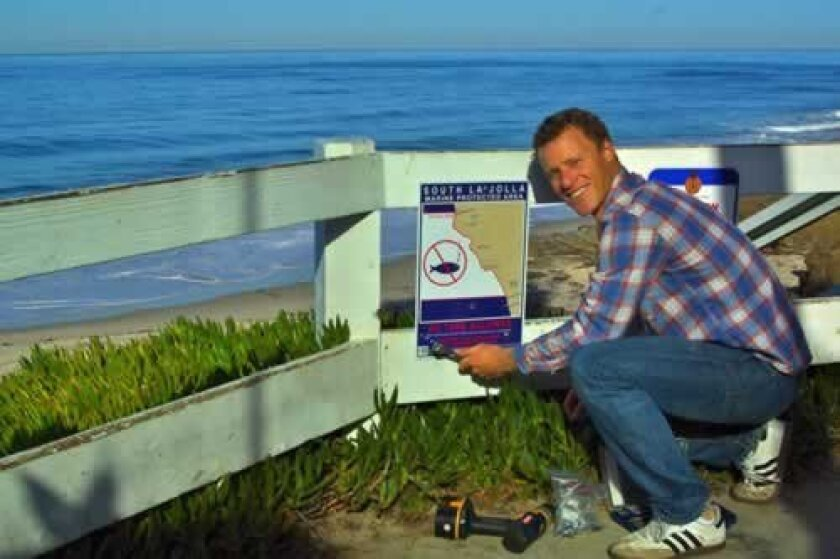 Wildcoast Conservation Director Ben McQue, of WindanSea, installed a sign at the end of Palomar Avenue in La Jolla Jan 30 identifying one of the four marine protected areas off the coast of La Jolla. Palomar Avenue is the northern boundary of the South La Jolla State Marine Reserve, which spans south to Diamond Street in Pacific Beach and about three miles offshore. Photos wildcoast.net