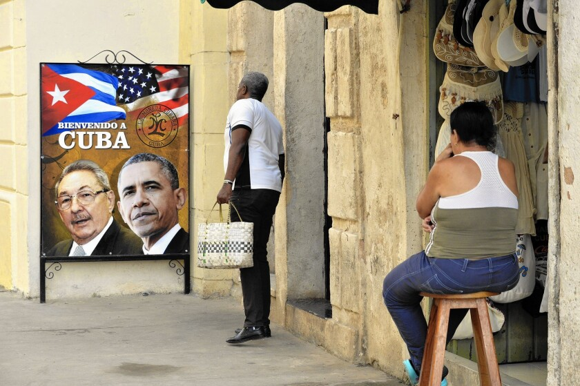 In Havana, a poster of Presidents Obama and Raul Castro heralds the U.S. leader's upcoming visit to Cuba.