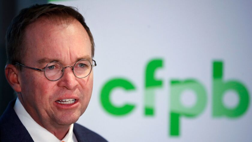 Mick Mulvaney speaks during a news conference after his first day as acting director of the Consumer Financial Protection Bureau in Washington on Nov. 27