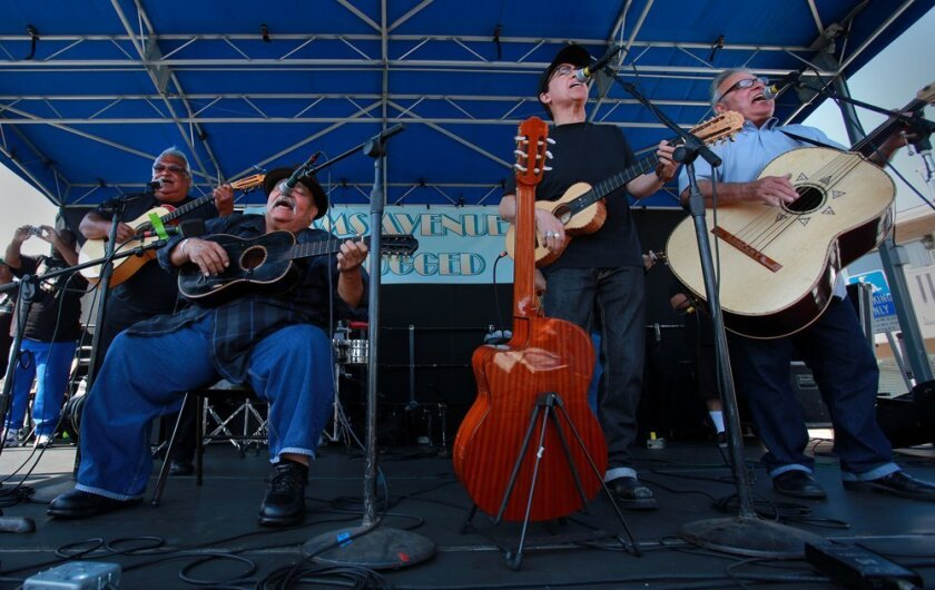 "Los Lobos members Louie Pérez (second from right) and David Hidalgo (far right) are shown performing at the 2013 Adams Avenue Unplugged festival with Los Alacranes members Ricardo Sanchez (far left) and Ramon ""Chunky"" Sanchez (second from left). The two bands first performed together in San Diego in the 1970s. Ramon Sanchez died in 2016."