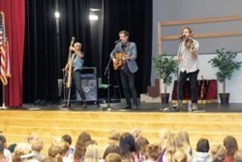 The Abrams Brothers performing for R. Roger Rowe School students. Photos/Jon Clark