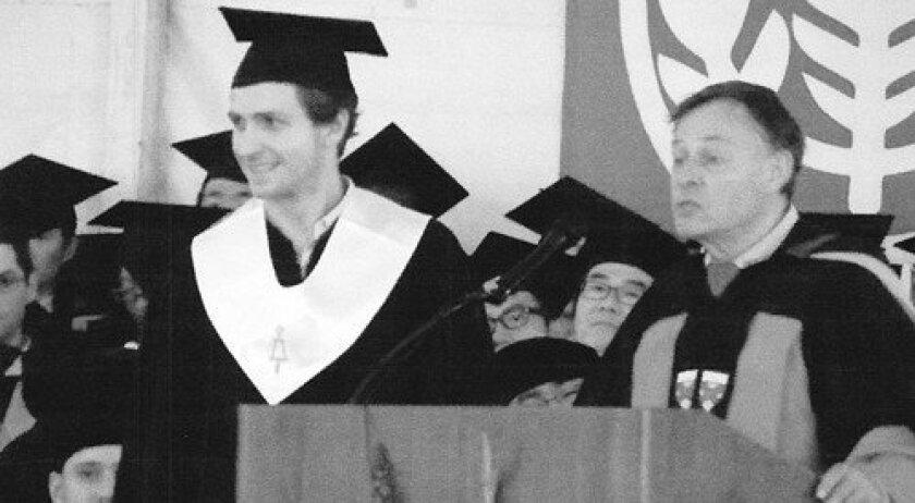 Parker Clark, left, receiving his degree