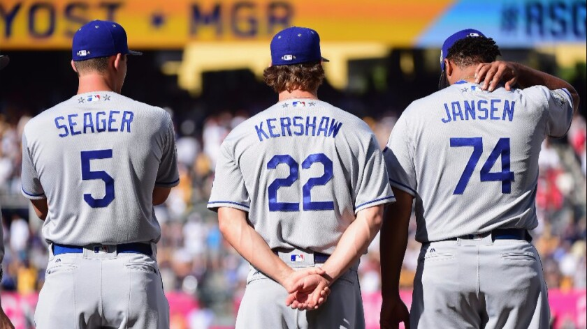 Dodgers Corey Seager, Clayton Kershaw and Kenley Jansen stand on the field before the All-Star Game on July 12.