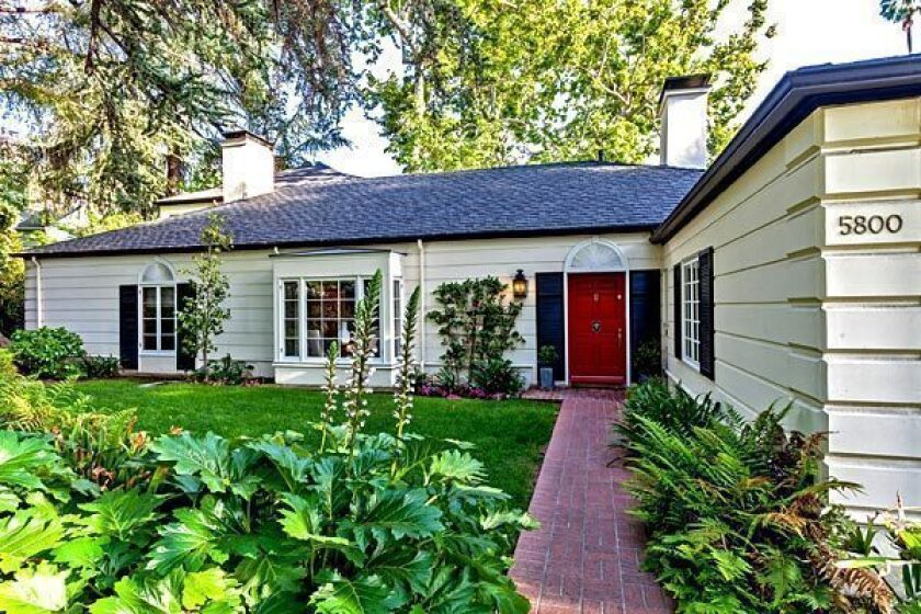 A brick path leads to the front door of the traditional-style home, which is listed at $3.095 million.
