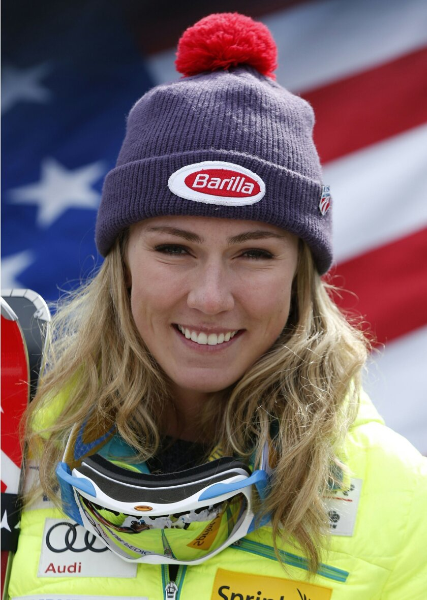 FILE - In this file photo dated Saturday, March 28, 2015, Mikaela Shiffrin, of USA, poses after winning the women's slalom ski race at the U.S. Alpine Championships, at Sugarloaf Mountain Resort in Carrabassett Valley, Maine USA.  During an interview with The Associated Press Friday Feb. 12, 2016,