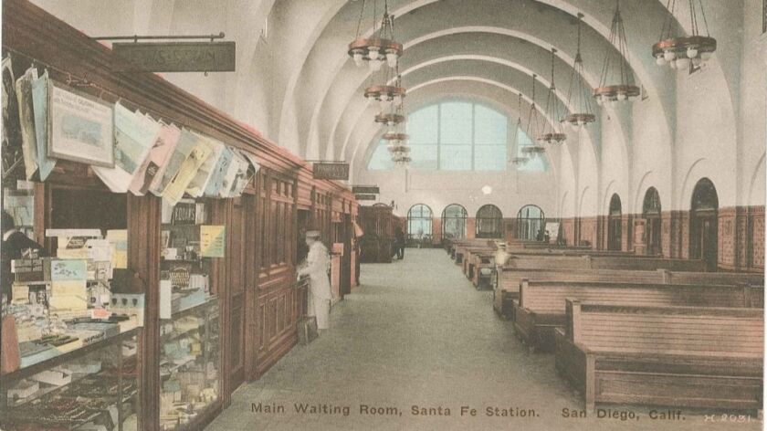 The waiting room included a line of concession stands on the south end. The chandeliers remain in pl