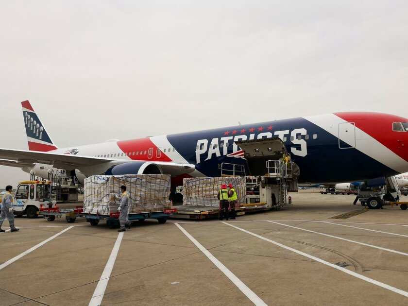 The New England Patriots team plane is loaded with N95 masks in Shenzhen, China.