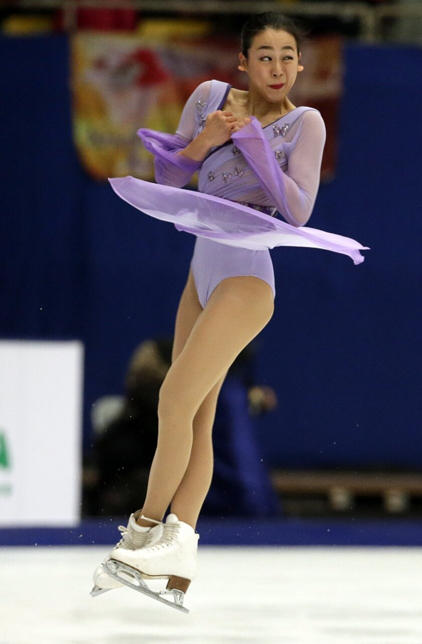 Japan's Mao Asada competes in the Ladies Free Skating program during the ISU Grand Prix of Figure Skating at the Capital Gymnasium in Beijing, China, Saturday, Nov. 7, 2015. (AP Photo/Mark Schiefelbein)