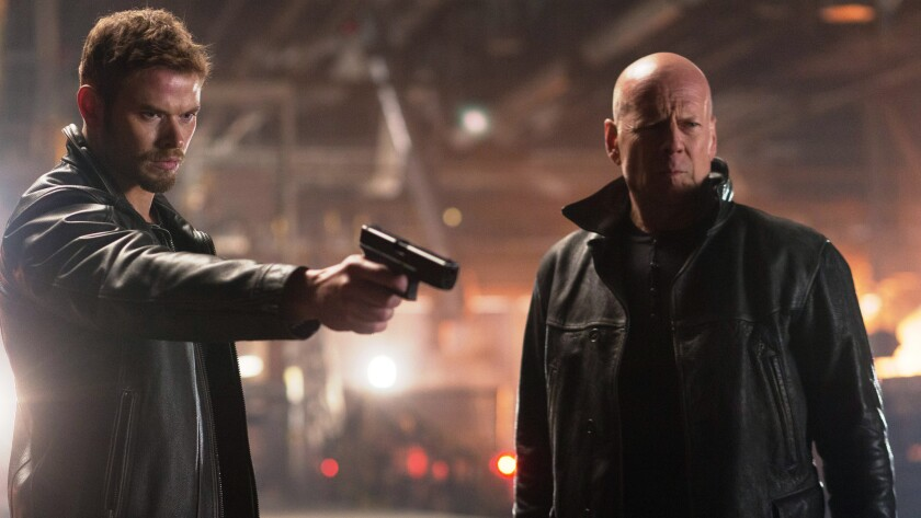 """Kellan Lutz, left, and Bruce Willis in the movie """"Extraction."""""""