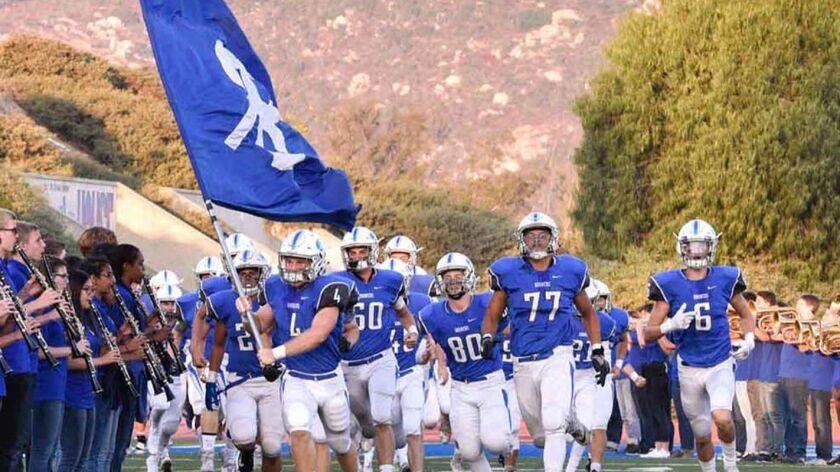 Members of the Rancho Bernardo High School Broncos varsity football team enter the stadium prior to