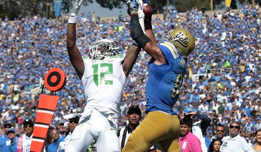 """UCLA receiver Jordan Payton, making a catch against Oregon before coming down out of bounds, says he has a """"good feeling that we'll definitely fix all this."""""""