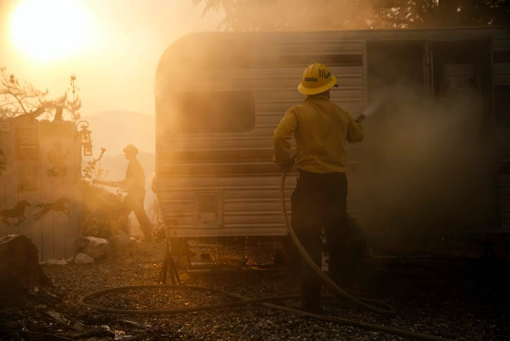 A fireman fights to contain the Kern County wildfire.