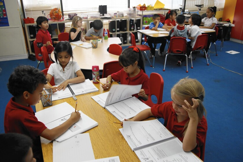Students work in a first-grade classroom at Metro Charter Elementary.