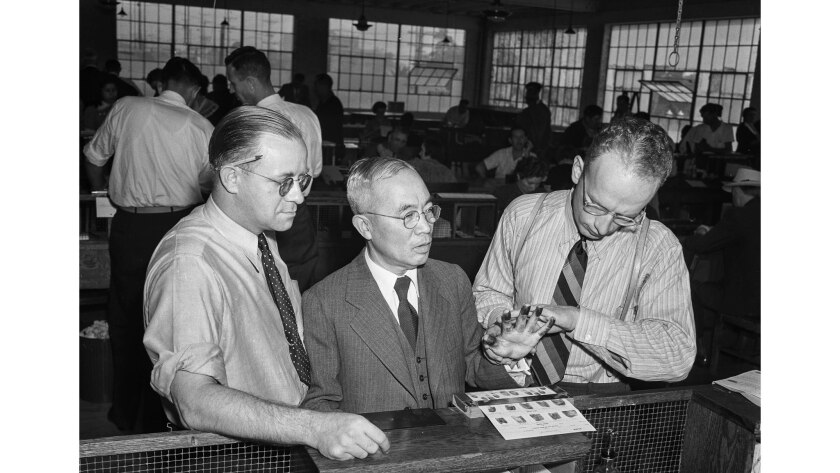 Aug. 28, 1940: Toyosaku Komai, publisher of Rafu Shimpo, a Los Angeles Japanese-English newspaper, is fingerprinted during the first day under the Alien Registration Act.