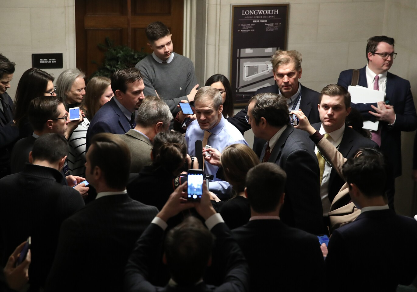 Rep. Jim Jordan (R-Ohio) speaks to reporters Friday after the House Judiciary Committee voted to approve two articles of impeachment.