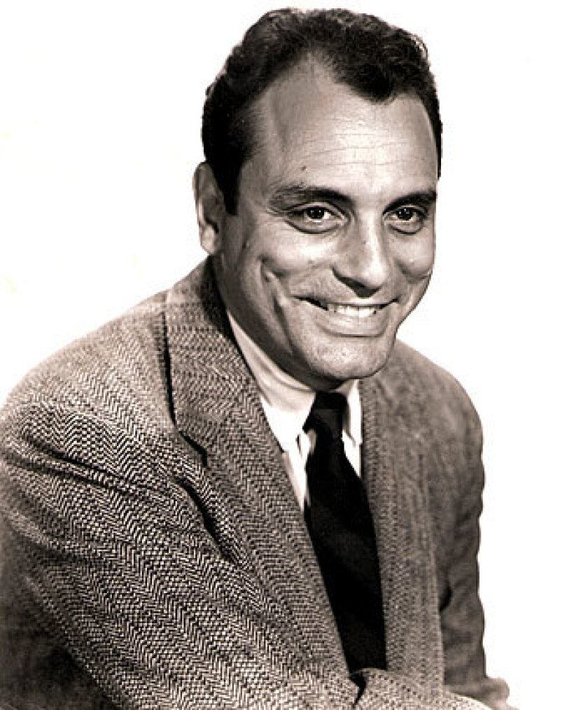 Joe Hyams, seen in 1957, was a former West Coast bureau chief for the New York Herald Tribune and covered Hollywood as a syndicated columnist from 1951 to 1964. He then continued chronicling Hollywood for the Saturday Evening Post, Ladies' Home Journal, Redbook and other magazines for several more years.