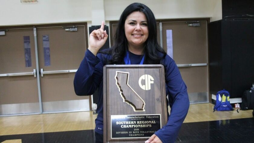 Montgomery High volleyball coach Debbie Isaia celebrates her team's win of the state regional championship in Murrieta.