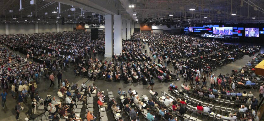 FILE - In this Wednesday, June 16, 2021, file photo, people attend the morning session of the Southern Baptist Convention annual meeting in Nashville, Tenn. At the national SBC gathering in June, thousands of delegates sent the message that they did not want the Executive Committee to oversee an investigation of its own actions on how it handled sexual abuse allegations. (AP Photo/Mark Humphrey, File)