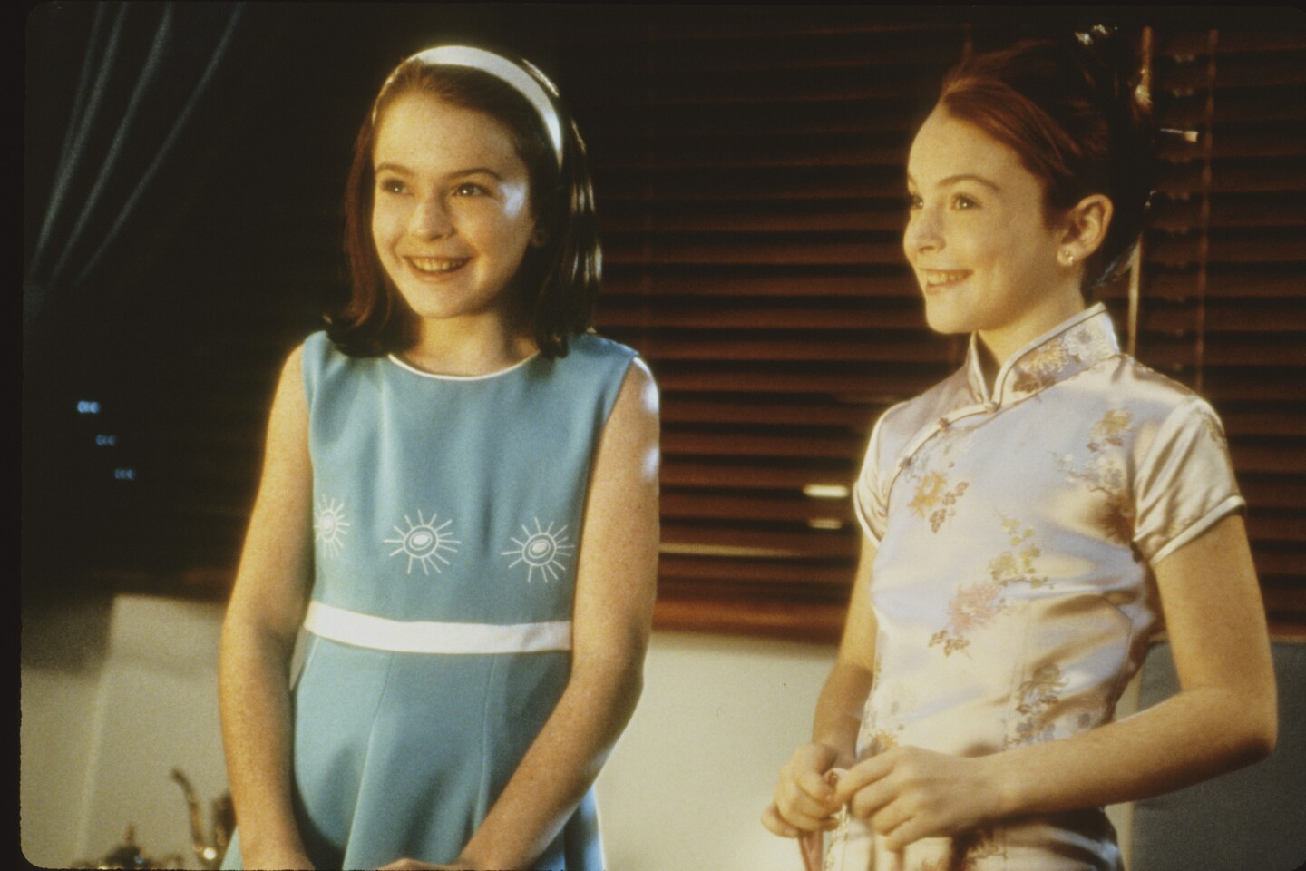 """Lindsay Lohan began her career at age 5, appearing in ads for Toys R Us and Calvin Klein Kids, among other brands. Her first acting role was on the sitcom """"Another World,"""" but she first came to national attention when she played the dual role of Hallie Parker and Annie James in the 1998 remake of """"The Parent Trap."""" Times film critic Kenneth Turan wrote at the time that the film """"can't be imagined without its 11-year-old redheaded star, Lindsay Lohan. Her bright spirit and impish smile make for an immensely likable young person we take to our hearts almost at once. Lohan's the soul of this film as much as Hayley Mills was of the original."""""""