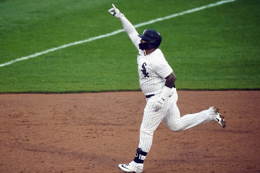 Chicago White Sox's Yermin Mercedes celebrates as he rounds the bases during the first inning of a baseball game after hitting a solo home run against the Kansas City Royals in Chicago, Thursday, April 8, 2021. (AP Photo/Nam Y. Huh)