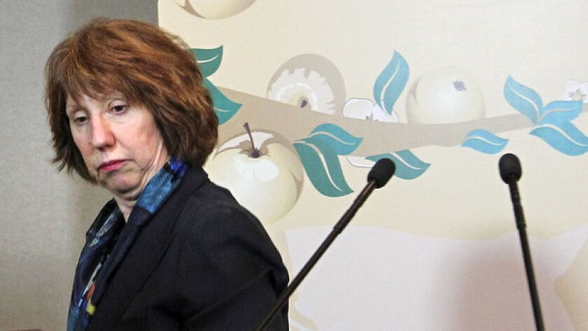 EU foreign policy chief Catherine Ashton leaves her news conference after the high-level talks between world powers and Iranian officials in Almaty, Kazakhstan.