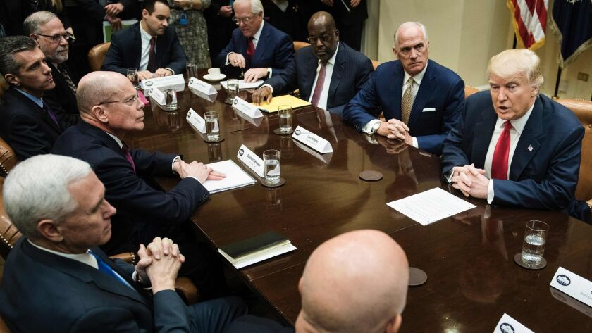President Trump and Vice President Mike Pence with CEOs last month: Among those who would benefit from repeal of the ACA pay rule are Stephen Hemsley of UnitedHealth Group (at Pence's left), David Cordani of Cigna (to Hemsley's left) and Joe Swedish of Anthem (fourth from right).