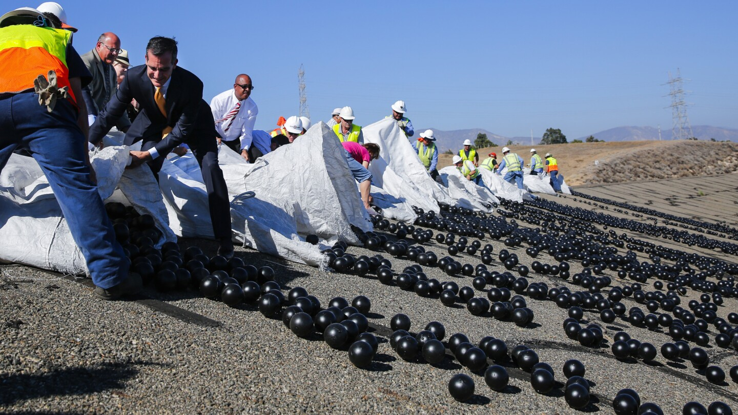 Mayor Eric Garcetti is joined by Department of Water and Power workers releasing the final 20,000 shade balls into the Los Angeles Reservoir in Sylmar.