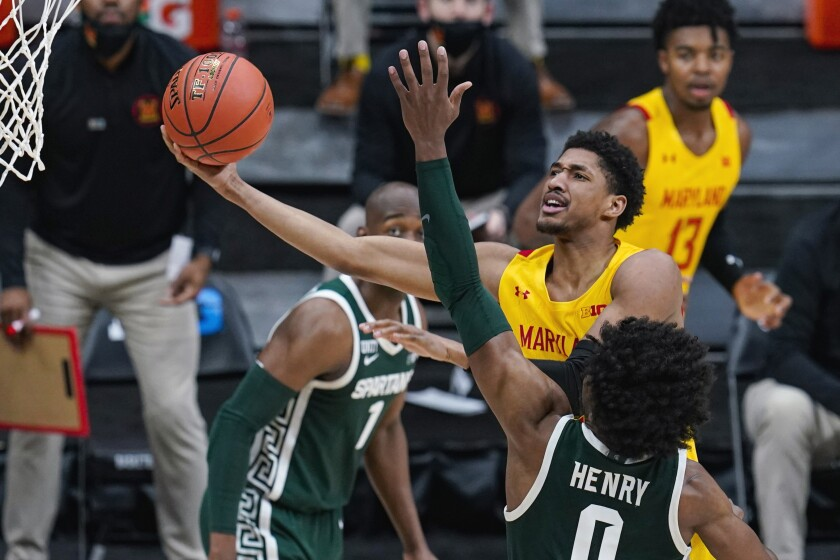 Maryland guard Aaron Wiggins (2) shoots over Michigan State forward Aaron Henry (0) in the second half of an NCAA college basketball game at the Big Ten Conference tournament in Indianapolis, Thursday, March 11, 2021. (AP Photo/Michael Conroy)