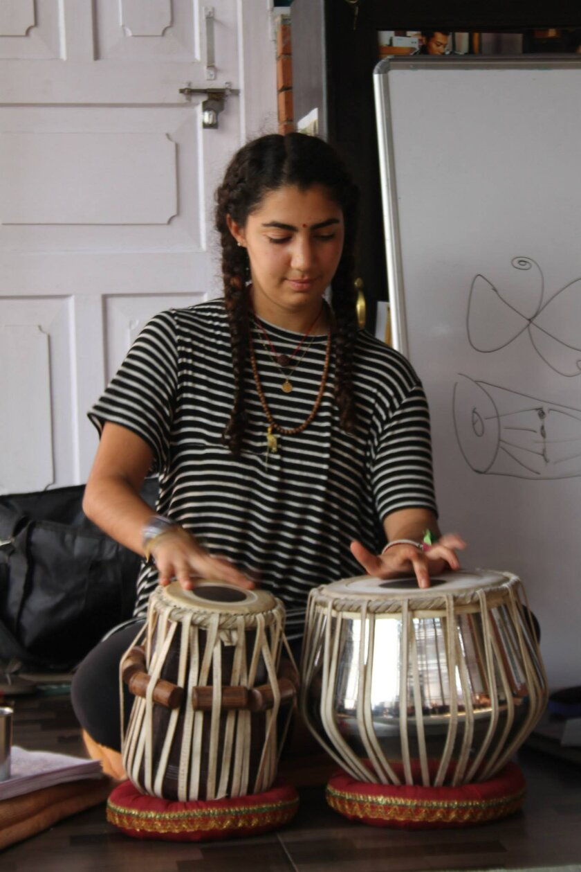 Lily Mojdehi plays the tabla drums for fellow students on her trip while presenting her independent study project at her program house in Kathmandu, Nepal.