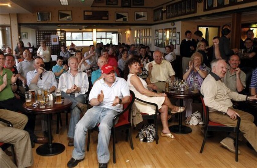 Golfers react as they watch tv at Rory McIlroy's home club of Holywood Golf Club, situated on the outskirts of Belfast, Northern Ireland, Sunday, April, 10, 2011, as Mcilroy competes in the Masters Golf Championship in Augusta, Georgia.  (AP Photo/Peter Morrison)