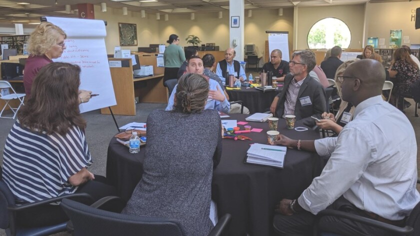 Stakeholders participate in Chula Vista's Digital Equity and Inclusion plan workshop in the Chula Vista Central Library.
