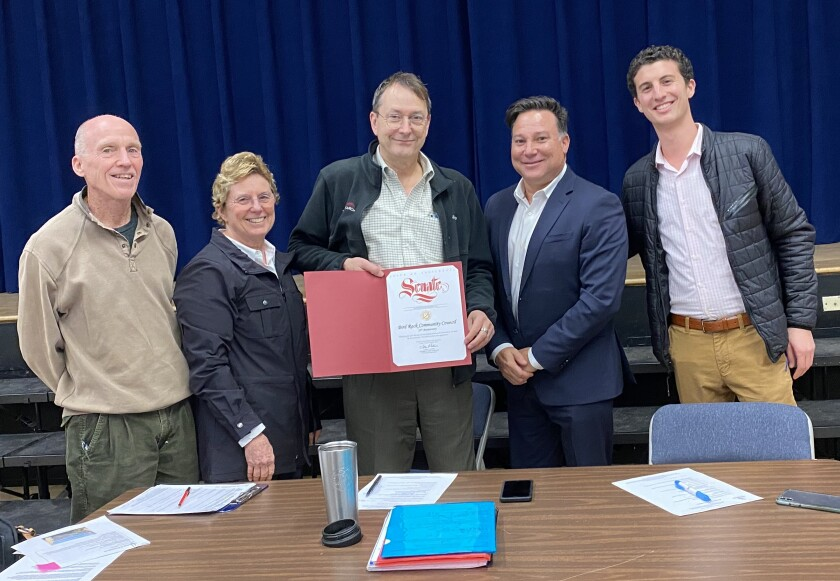 State Senator Toni Atkins rep Miller Saltzman (right) presents a commendation recognizing the 25th anniversary of the Bird Rock Community Council to board members David Dunbar, Barbara Dunbar, John Newsam and Joe Parker at the group's Feb. 4 meeting.