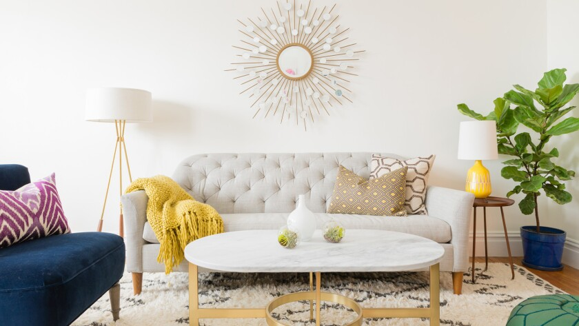 """After the redesign by Decorist designer Chrissy Burgess, """"channeling Emily Henderson and a bit of 'Mad Men,' and mixing colors, patterns and styles into one cohesive look."""""""