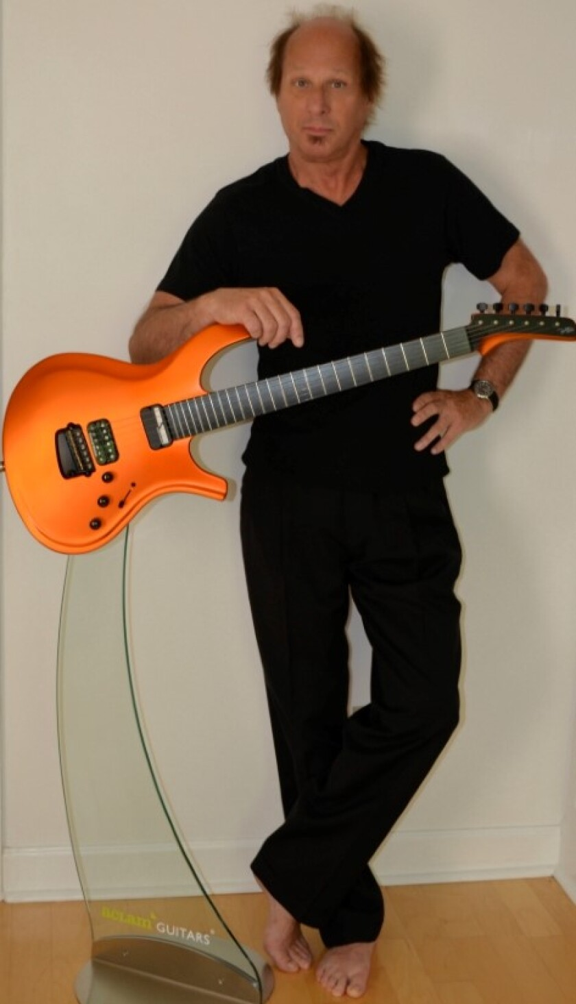 Guitar wizard Adrian Belew is now on tour with his new band. They perform Friday at the Music Box.