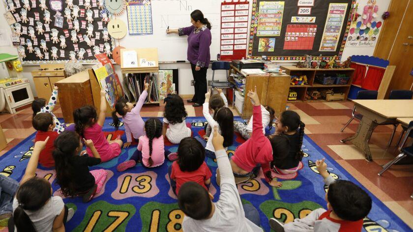 LOS ANGELES, CA MAY 12, 2015 -- Teacher Celia Cendejas leads the Pre-K students in the School Rea