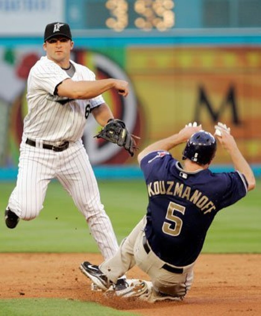 The Padres' Kevin Kouzmanoff is out at second base as Florida Marlins' Dan Uggla throws to first for the double play in Miami Friday. AP Photo/Alan Diaz