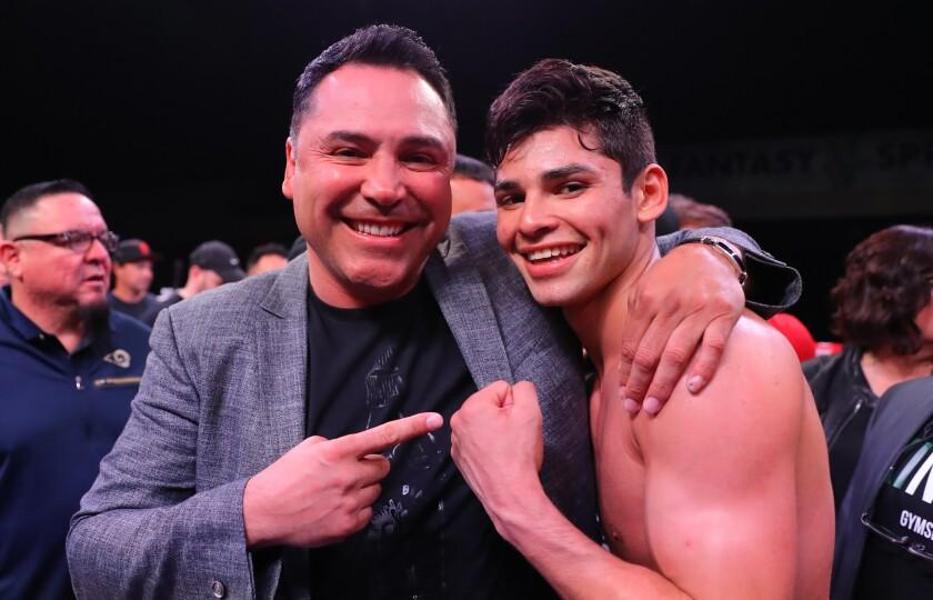 Ryan Garcia celebrates with Oscar De La Hoya after his victory over Jose Lopez on March 30.
