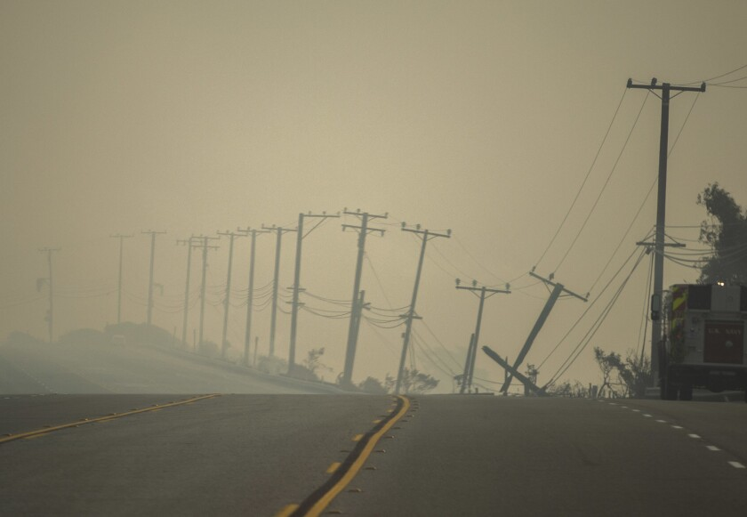 Power lines damaged by the Woolsey fire droop along the southbound Pacific Coast Highway near Leo Carrillo State Beach on Nov. 10.