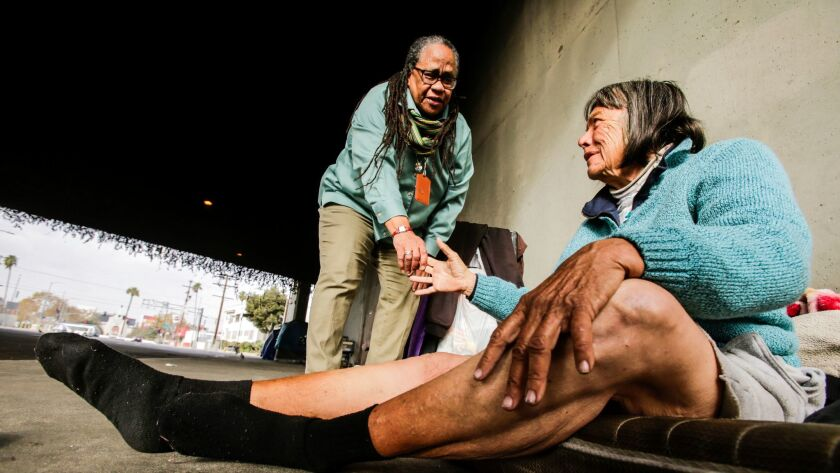 Jeanette Rowe, now-retired head of outreach for Los Angeles Homeless Services Authority, talks to a homeless woman in 2016.