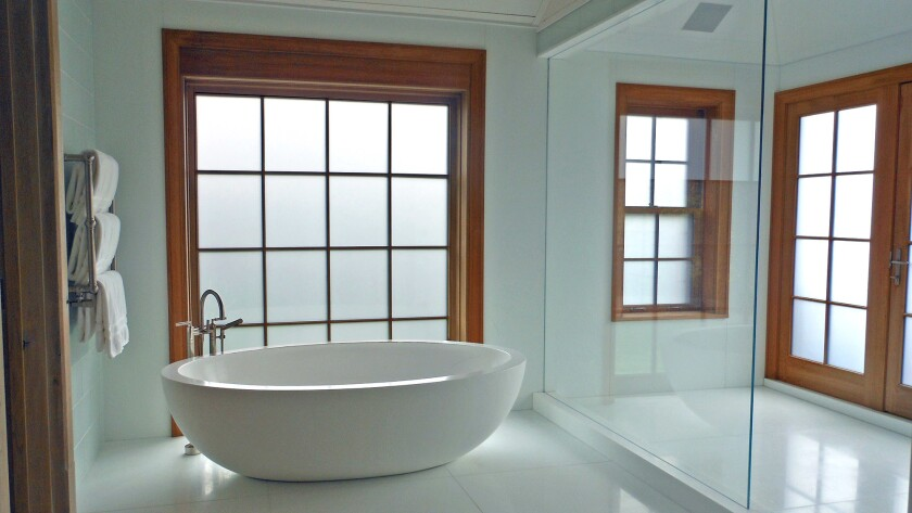 Electronically activated privacy glass changes opacity.