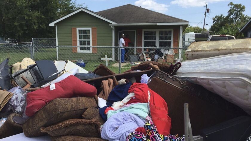 Steven Williams helped his wife clean out her grandmother's house after Hurricane Harvey flooded their town of Port Arthur. Very little could be saved from the house.