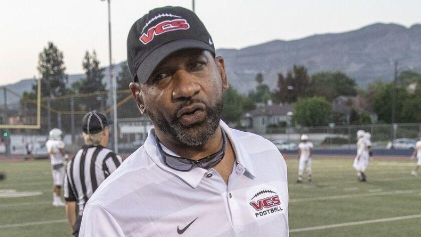 BURBANK, CALIF. -- FRIDAY, AUGUST 17, 2018: Former USC runningbacks coach Todd McNair talks with on