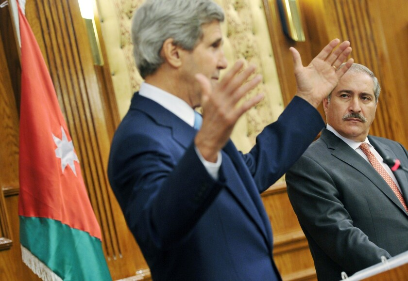 Jordanian Foreign Minister Nasser Judeh watches as U.S. Secretary of State John F. Kerry answers questions following his meeting with Arab League officials.