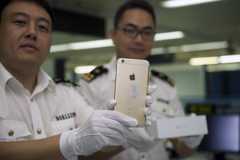 Chinese authorities display illegal iPhone 6 phones in Shenzhen on Sept 23.