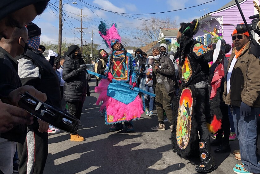 Mardi Gras Indians dress in flamboyant suits in honor of Native Americans.