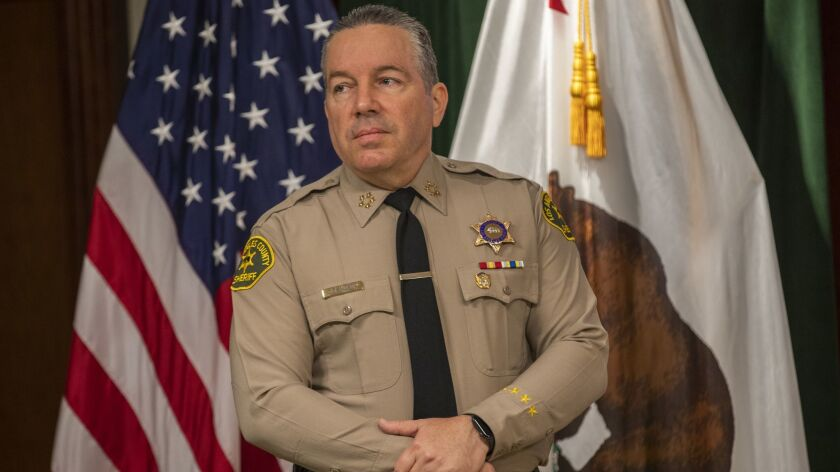 L.A. County Sheriff Alex Villanueva waits to speak during a media open house at the Hall of Justice in 2019.