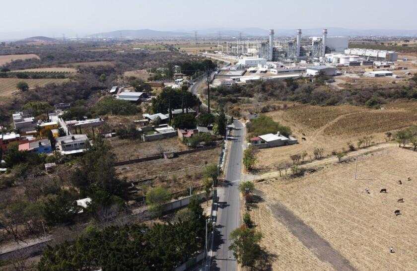 An aerial photo shows a power plant against a skyline
